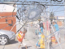 ??  ?? CRACK IN THE SYSTEM: This bakkie's windscreen stopped a stray bullet when a gunfight broke out in Manenberg as the local Community Police Forum prepared to embark on a anti-gangsteris­m march. Girls in the area live with gangster shootings...