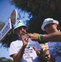 ?? (Tomer Neuberg/Flash90) ?? ACTIVISTS IN Tel Aviv's Rabin Square mark '4/20' during a demonstration calling to legalize marijuana.