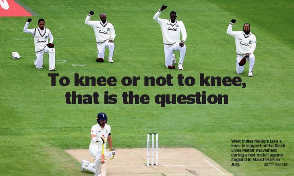 ?? GETTY IMAGES ?? West Indies fielders take a knee in support of the Black Lives Matter movement during a test match against England in Manchester in July.