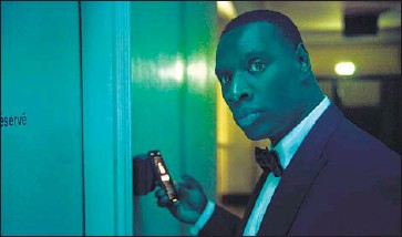 """?? NETFLIX Emmanuel Guimier ?? in June launched an e-commerce website that sells Netf lix merchandise and products based on and inspired by shows including """"The Witcher"""" and """"Lupin."""" Above, Omar Sy plays a gentleman thief in """"Lupin."""""""