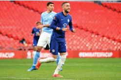 ?? Associated Press ?? ↑ Chelsea's Hakim Ziyech celebrates after scoring his side's opening goal against Manchester City during their English FA Cup semi-final match in London on Saturday.