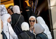 ?? — AFP ?? Women queue outside a Louis Vuitton store in Istanbul. The Turkish lira has nosedived against the dollar.