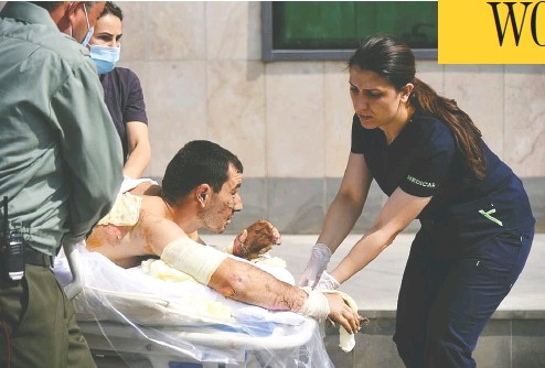 ?? Foreign Ministry of Armenia / Handout via REUTERS ?? Medics attend to a civilian injured during clashes in the breakaway region of Nagorno-karabakh in Azerbaijan on Sunday. A decades-long conflict over disputed land has erupted into renewed war.