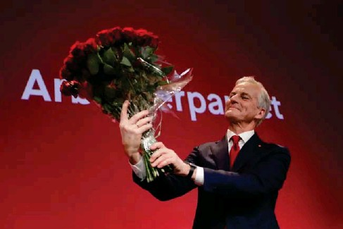 ?? (NTB/AFP/Getty) ?? Labour Party l eader Jonas Gahr Stoere ce l ebrates in Os l o on Monday
