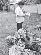 ??  ?? A distributor of Jaffna Thinakkural paper was attacked and his motorbike was set ablaze by unidentified people early morning yesterday. The picture shows the torched motorbike and newspapers. TNA Parliamentarian E. Saravanapavan is at the...