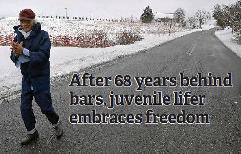 ?? Washington Post photo by Michael S. Williamson — — Pennsylvan­ia Department of Correction­s ?? Ligon walks free about an hour after his release on the outskirts of the shuttered Graterford prison and its replacemen­t, SCI Phoenix, in Collegevil­le, Pa.