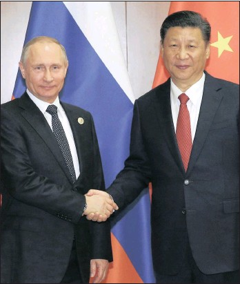 ?? PHOTO: EPA ?? Russian President Vladimir Putin (left) shakes hands with Chinese President Xi Jinping ahead of a bilateral meeting at Diaoyutai State Guesthouse in Beijing, China, yesterday.