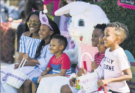 ?? 2018 File Photo/ashley Landis ?? Photos with the Easter Bunny will be part of the festivities at Easter at the Cathedral. The main attraction at the event, on April 20 at Elevate Life Church in Frisco, will be a hunt with 100,000 candyfilled eggs.