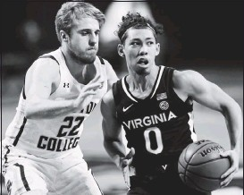 ?? THE ASSOCIATED PRESS ?? Virginia's Kihei Clark, shownworking against Boston College's Rich Kelly on Saturday, scored 19 points against Notre Dame last month. UVA faces the Irish againWednesday.