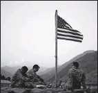 ?? THE ASSOCIATED PRESS ?? In 2011, U.S. soldiers at Forward Operating Base Bostick in Kunar province, Afghanistan, sat beneath an American flag raised to commemorate the 10th anniversary of the 9/11 attacks.