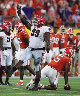 ?? CURTIS COMPTON AP ?? Georgia defensive lineman Jordan Davis and the Bulldogs moved up three spots in the AP Top 25 after beating then-No. 3 Clemson on Saturday in Atlanta.