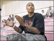 ?? MIKE MAPLE/THE COMMERCIAL APPEAL ?? Omar Sneed, who played at Memphis from 1997-99, cheers during the 13-and-under AAU national tournament Saturday. Sneed is back this weekend to watch his son, Jalen, compete.