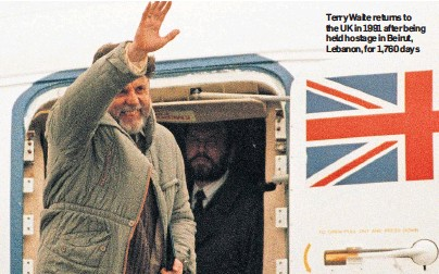 ??  ?? Terry Waite returns to the UK in 1991 after being held hostage in Beirut, Lebanon, for 1,760 days