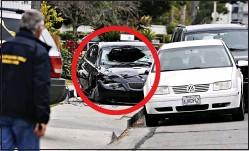??  ?? AFTERMATH: Rodger's bullet-riddled black BMW in which he died