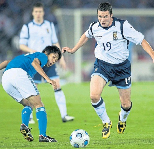 ??  ?? NATIONAL DUTY: Don Cowie makes his Scotland national team debut against Japan in Yokohama in October 2009 – the midfielder went on to win 10 caps