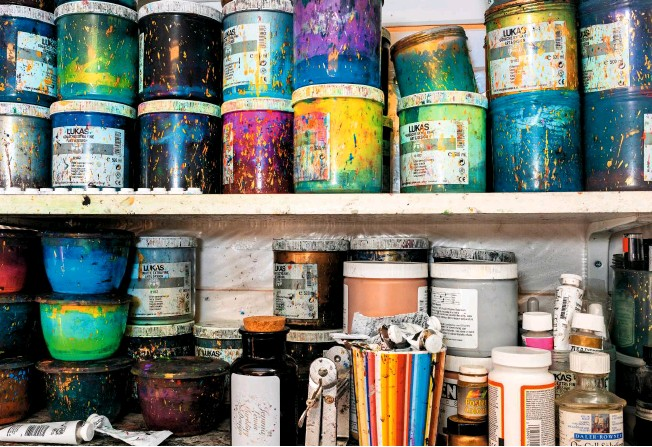 ??  ?? Splashed pots of vivid colour are stacked up on the shelves in Jemma's Wiltshire studio, ready to transform her paper into dazzling patterns.