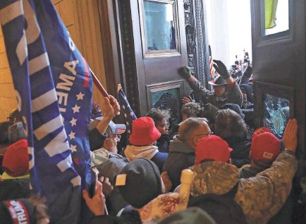 ?? GETTY IMAGES ?? After President Donald Trump urged his supporters to go to the Capitol, rioters stormed the building.