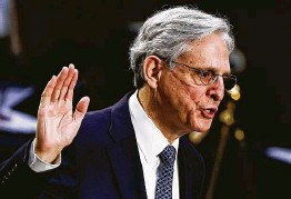 ?? Carlos Barria / Getty Images ?? Judge Merrick Garland, nominee for attorney general, vowed to uphold the independen­ce of a Justice Department that was politicize­d under President Trump.