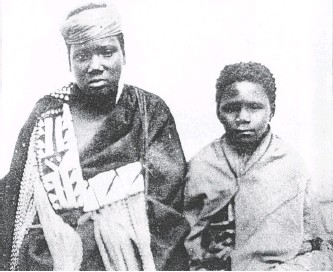 ??   South African Library, Cape Town ?? THE story behind the photograph: Professor Jeff Peires told how the picture of Nongqawuse (LEFT) came to be taken. While in Grahamstown, she and another (copycat) prophetess also linked to the cattle killing, Nonkosi, were staying with Major John Gawler, an army officer, and his wife. She (Mrs Gawler) dressed her in a blanket and took her to have her photograph taken along with Nonkosi, said Peires. The year was 1858 and photographer, MH Durney, was the man who captured the image of the sad-faced Nongqawuse. Given her age, then about 16, many had instantly assumed that the smaller Nonkosi was Nongqawuse and the two had often been misidentified over the years, said Peires.