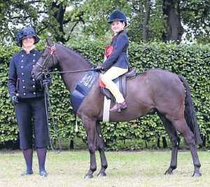 ??  ?? The mini show pony championship went to Dunblane with Barkway Minstrel, led by Jill Dolan and ridden by Alfie Dolan McLachlan, 7.