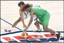 ??  ?? United States' Darius Garland (25) and Nigeria's Caleb Agada (3) chase the ball during an exhibition basketball game, on July 10, in Las Vegas. (AP)