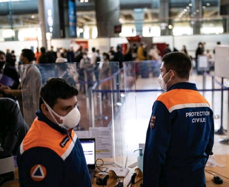 ?? Getty images File ?? TAKING PRECAUTIONS: A COVID-19 checkpoint where passengers can be tested is seen inside Roissy Charles de Gaulle Airport outside Paris in April.