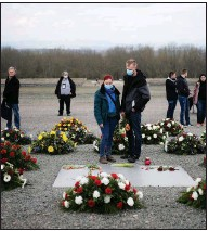 ?? More photos at arkansasonline.com/412buchenwald/. (AP/Markus Schreiber) ?? People stand among the wreaths after a ceremony Sunday in Weimar, Germany, to mark the 76th anniversary of the liberation of the Nazis' Buchenwald concentration camp. Holocaust survivors from different parts of the world attended the memorial ceremony online because of the pandemic.