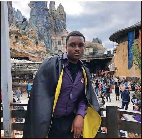 ?? Courtesy of Jaalin Harvey ?? In an essay online, Jaalin Harvey, 24, pictured at Disney's Hollywood Studios, recounts shopping experiences he says every Black person has had: being trailed in a store.