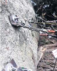 ?? PHOTO: SUPPLIED ?? Boulder progress . . . A huge boulder above Blueskin Rd, Dunedin, is restrained by cables.