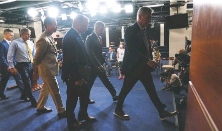 ?? JABIN BOTSFORD/THE WASHINGTON POST ?? House Minority Leader Kevin Mccarthy (R-calif.) and other GOP lawmakers exit a Wednesday news conference where he said he was pulling all five of his nominees to a panel investigating the Capitol attack after House Speaker Nancy Pelosi (D-calif.) moved to block two.