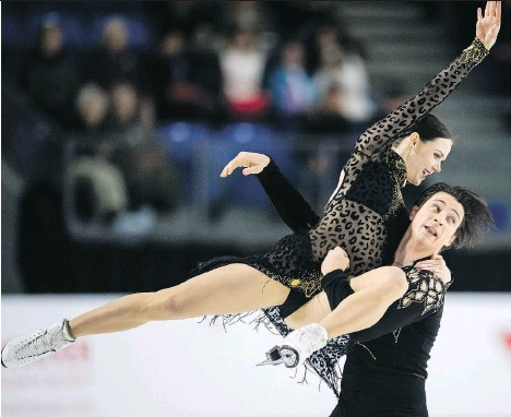 ?? JONATHAN HAYWARD/THE CANADIAN PRESS ?? Canadian ice dance darlings Tessa Virtue and Scott Moir enter the Pyeongchang Olympics with nothing left to prove following a gold medal at the Vancouver Games and silver at Sochi in 2014, but the desire to compete and succeed still burns inside them.