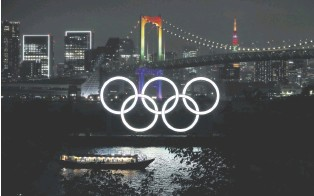 ??  ?? The Rainbow Bridge and Tokyo Tower illuminated in Olympic colors to mark 100 days until the Tokyo 2020 Olympics, Tokyo, Japan, April 14, 2021.