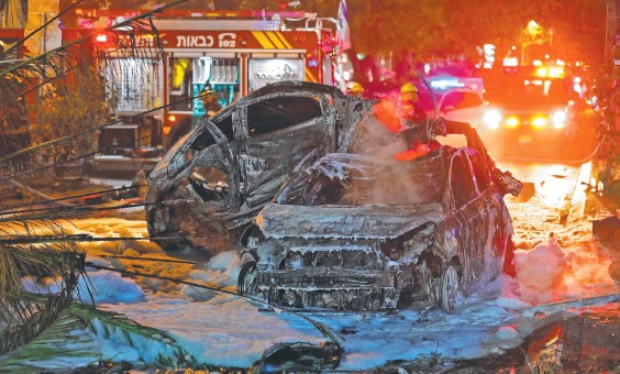 ??  ?? Burntout cars in the Israeli town of Holon near Tel Aviv, after rockets slammed into the area. Picture: Ahmad Gharabli/AFP