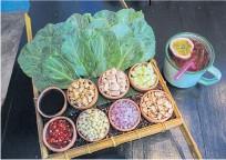 ??  ?? Miang khana, DIY kale leaf wrap, and passion fruit tea.