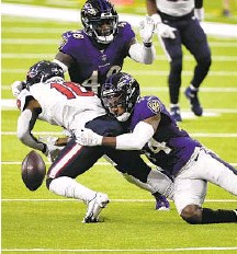?? ERIC CHRISTIAN SMITH/AP ?? Ravens cornerback Marlon Humphrey forces Texans wide receiver Keke Coutee to fumble during the first half of their Week 2 game.