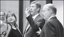 """?? Pool photo by Gary W. Green ?? """"It's what I do"""": Mark O'mara, center, with Angela Corey and Bernie de la Rionda at George Zimmerman's hearing Thursday in Sanford, Fla."""