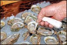 ?? Ap-phil sears, File ?? In this 2013 photo, oysters are displayed in Apalachicola, Fla. The Supreme Court has ruled unanimously for Georgia in its longrunning dispute with Florida over water. The court on April 1 rejected Florida's claim that Georgia uses too much of the water that flows from the Atlanta suburbs to the Gulf of Mexico.