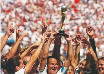 ?? MICHAEL CAULFIELD/AS­SO­CI­ATED PRESS ?? The U.S. women's na­tional team's win over China at the 1999 World Cup helped raise the pro­file of the sport and its play­ers.