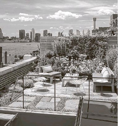 """?? New York Times ?? A living roof that Andrew Franz, an architect, installed for clients in New York. The layers of soil and vegetation created an """"insulated building envelope"""" that significantly reduced heating and cooling costs, said Franz."""