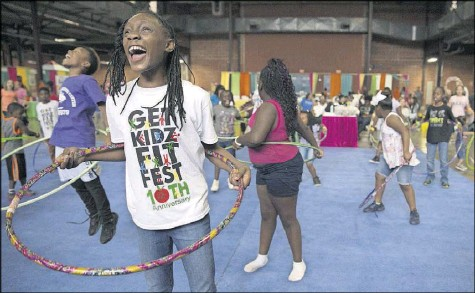 ?? File Photo ?? Secret Ellis (front) and other contestants get ready for a hula hoop competition at the 2017 festival.