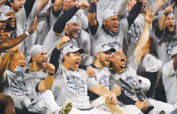 ??  ?? CELEBRATION – Members of the Tampa Bay Rays pose with the William Harridge Trophy after defeating the Houston Astros in Game 7 of the American League Championship Series 4-2 yesterday at PETCO Park in San Diego, California. (AFP)