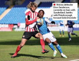 ??  ?? ■ Wolves defender Dion Sanderson, currently on loan with Sunderland, battles with Peterborou­gh forward Siriki Dembele
