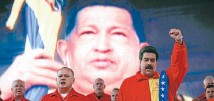 ?? Photo: REUTERS ?? Living on: Hugo Chavez dominates President Nicolas Maduro, right, and assembly president Diosdado Cabello.