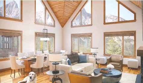 ?? SPRING CREEK ?? The great room of a condo in Spring Creek features glorious vaulted ceilings and huge windows to take in the mountain scenery.