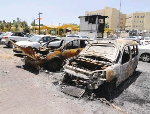 ?? (Marc Israel Sellem/The Jerusalem Post) ?? CARS THAT were burned during riots in Lod in May.