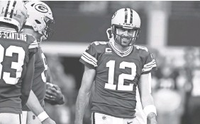 ?? MATTHEW EMMONS / USA TODAY SPORTS ?? Packers quarterback Aaron Rodgers had reaason to smile Sunday at Dallas.