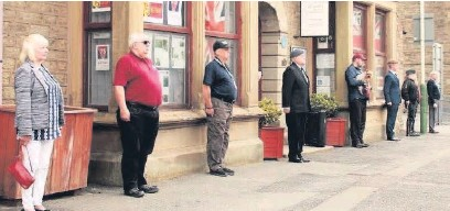 ??  ?? ●● Members of Veterans In Communities in Haslingden, observed the two-minute silence for VE Day 75 outside their Bury Road centre