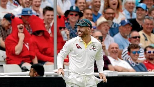 ?? GETTY IMAGES ?? Controversial Australian batsman David Warner shows his sandpaper-free pockets to the Edgbaston crowd.