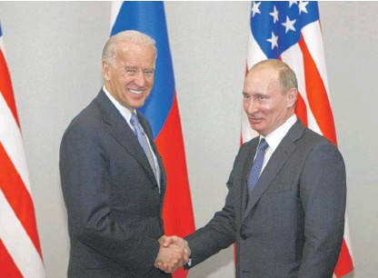 ?? ALEXANDER ZEMLIANICHENKO/AP FILE ?? Then-Vice President Joe Biden shakes hands with Russia's then-Prime Minister Vladimir Putin in Moscow in 2011. New START, negotiated while Biden served as vice president, limits the United States and Russia to 1,550 deployed nuclear warheads on strategic weapons like submarines, bomber aircraft and land-based intercontinental ballistic missiles.