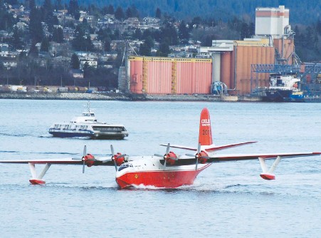 """?? GERRY KAHRMANN/FILES ?? The Martin Mars water bomber Hawaii Mars, photographed in 2008, now sits idle on the shores of Sproat Lake as B.C. battles wildfires. It was retired in 2015, but its owner says the B.C. Wildfire Service should be using """"every tool in the tool box"""" during wildfire season."""